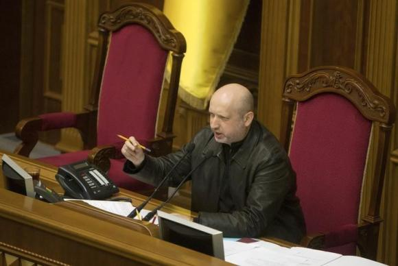 Newly elected speaker of parliament Oleksander Turchynov attends a session of the Ukrainian parliament in Kiev
