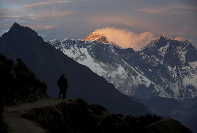 Light illuminates Mount Everest during sunset in Solukhumbu district also known as the Everest region